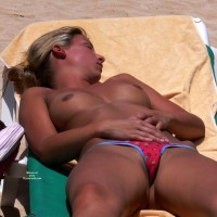 Very Well Tanned Topless Beach Girl - Blonde Hair, Camel Toe, Topless Beach, Topless, Beach Tits, Beach Voyeur , Topless Sunbating, Camel Toe, Medium Dark Brown Areolas, Beach Titties, Medium Breasts, Sunbather Asleep, Brown Nipples, Asleep At The Beach, Red Panties With Flower Print