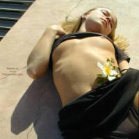 Girl Lying On Her Back , Girl Lying On Her Back, Black Top Lifted, Flowers, Laying On Pavement