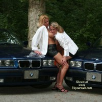 Erotic Pose In Front Of Two BMW - Black Hair, Blonde Hair , Black Strappy Heels, Bmw Hot Posing, Lesbian Tit Lickers, White Shirts, Lesbo Tit Taster, Sexy Mature Women, Shiny Black Skirts, White Blouses, Black Mini, Slack Strap Sandals, Lesbian Licking