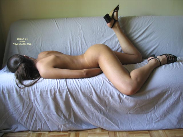 Nude Girl Lying On A Sofa - Black Hair, Leg Up, Sandals , Nude Girl Lying On A Sofa, Lying On Her Belly, Leg Up, Black Hair, Black Sandals, Laying Down On Sofa, Black High Heeled Sandals, Hiding Everything