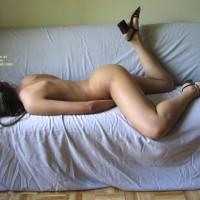 Nude Girl Lying On A Sofa - Black Hair, Leg Up, Sandals , Nude Girl Lying On A Sofa, Lying On Her Belly, Leg Up, Black Hair, Black Sandals, Laying Down On Sofa, Black High Heeled Sandals, Hiding Everything