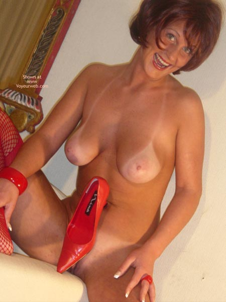 Nude Girl Sitting - Tan Lines , Nude Girl Sitting, Tanlines, Covering Her Pussy With A Red Shoe, Mature Woman, Deep Tanlines, Red Fishnets, Red Pumps, Freckled Chest, Light Pink Areola