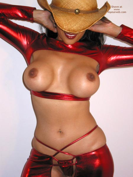 Semi-nude With Exotic Costume In Red , Semi-nude With Exotic Costume In Red, Large Enhanced Breasts With Erect Nipple, Straw Hat Over Face Except For Mouth